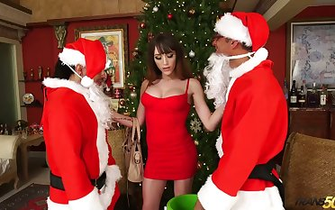 Two dudes in Santa Clause outfits fuck busty ladyboy Kylie Maria