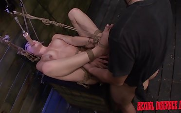 Kinky unfocused in the air rope bondage gets fucked by a big cock