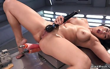 Asian shovs humping machine up her butt
